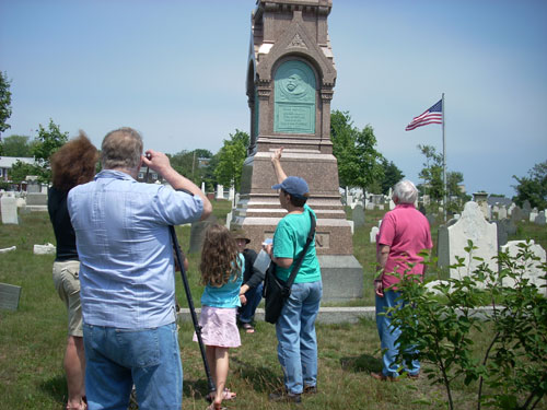 barb informs a group about the Alden monument