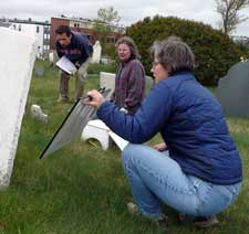 Art, April and Martha read a marble stone with a mirror
